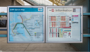 Caltrain and BART signs at Millbrain show need for regional maps